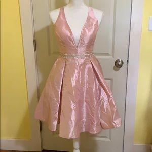 Pink mini dress, plunging halter & back detail